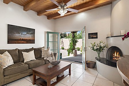 The Family Room has a Kiva Fireplace and French Doors...