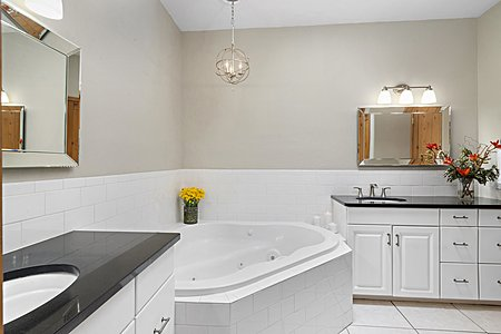 The Owners' Bathroom with Jetted Tub and Walk-in Closet...