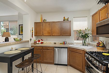 Stainless Steel Appliances in the Kitchen include a Five-burner Gas Stove with Double Ovens