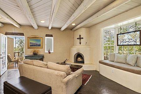 Living Room with Bay Window and Kiva Fireplace