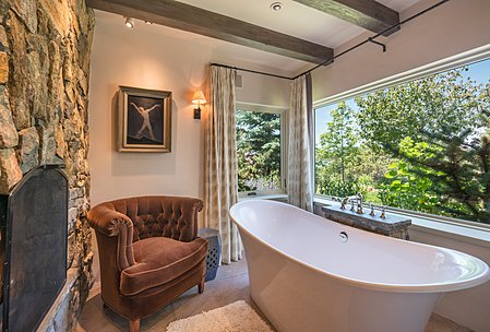 Separate Bathing Room with Victoria-Albert Soaking Tub and Stone Fireplace also has Wonderful Views