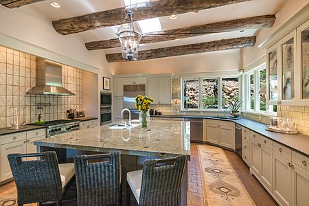 The Gourmet Kitchen with High-end Appliances and Counter Seating...