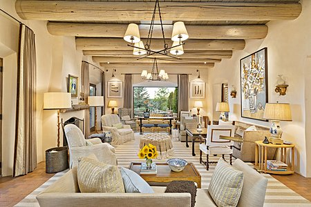The Elegant Living Room has Sets of French Doors to Outdoor Living Spaces...