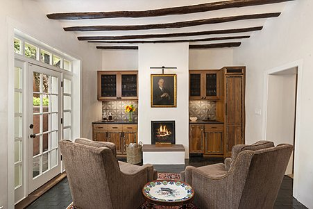 The After-dinner Parlor with Fireplace accesses the Gardens