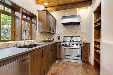 Guest House Kitchen has Custom Cabinets and Tiles