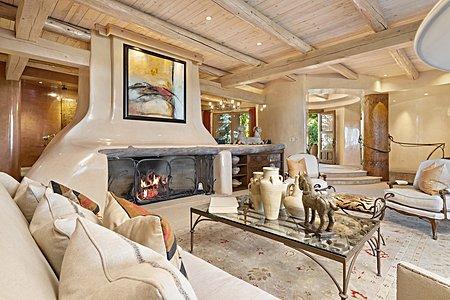 Shepherds fireplace in formal living room looking toward entry foyer