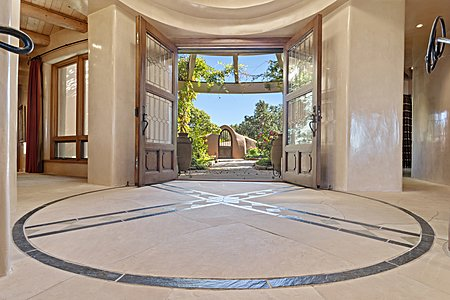 Entry foyer looking toward outdoor courtyard and gate