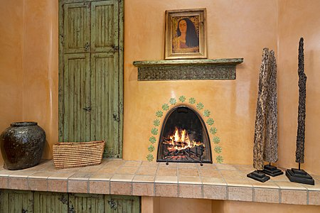 Kiva fireplace in den outside library