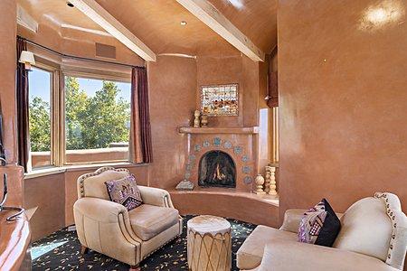 Kiva fireplace in upper level game room