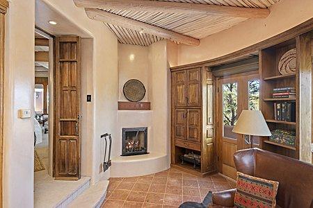 Kiva fireplace in office
