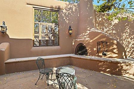 Gate house patio with kiva fireplace
