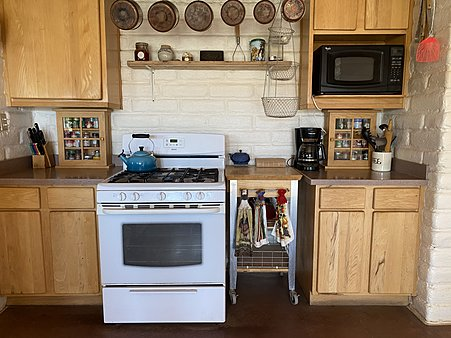 Kitchen - Oven and Microwave, room for a Viking Stove